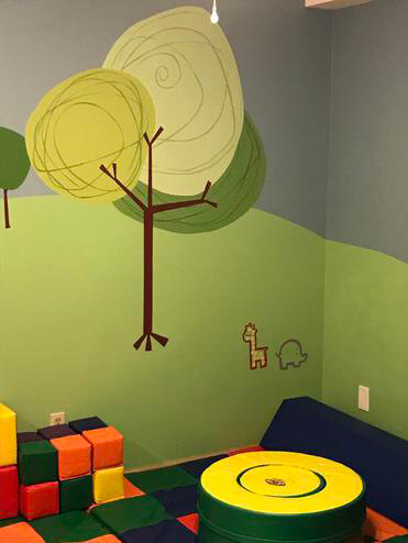 building blocks and kids table with decorative toddler wallpaper